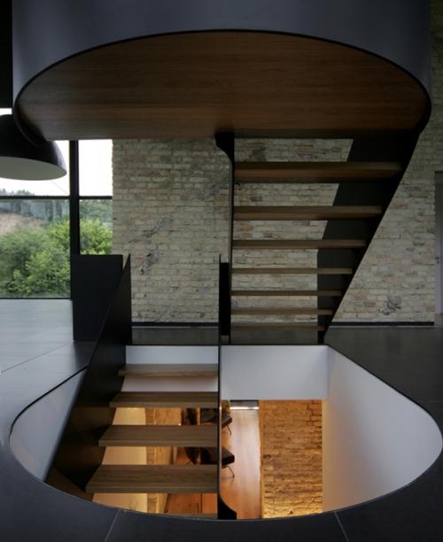 Una casa que goza de 360 grados de vistas al parque by G. Natkevicius & Partners